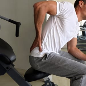 Man working out with back pain for uncle buds OTC Hemp pain relief post